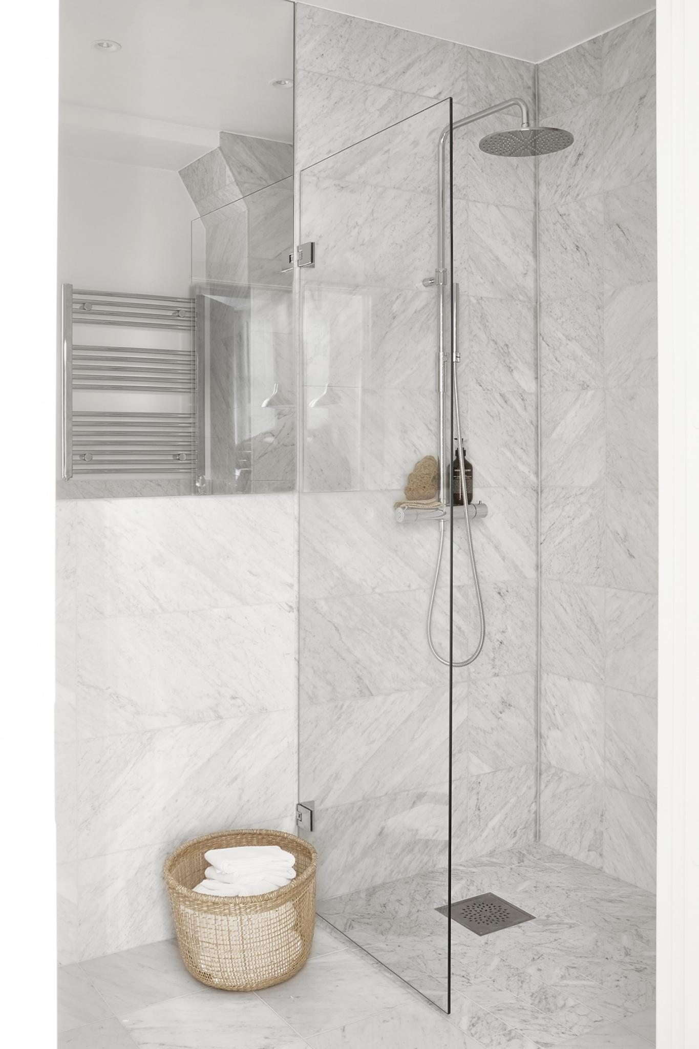 Bathroom shower with marble. Small Stockholm apartment decor inspiration.